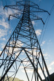 Electrical transmission tower with wires. Electrcial transmission tower with blue sky stock image