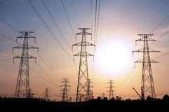 Electrical Transmission Towers. At sunset Royalty Free Stock Photography
