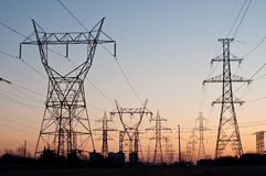 Electrical Transmission Towers (Electricity Pylons. A long line of electrical transmission towers carrying high voltage lines Royalty Free Stock Images