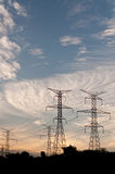 Electrical Transmission Towers -Electricity Pylons. A long line of electrical transmission towers carrying high voltage lines Royalty Free Stock Photo