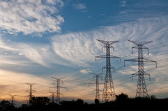 Electrical Transmission Towers-Electricity Pylons. A long line of electrical transmission towers carrying high voltage lines Stock Image