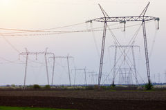 Electrical transmission towers in perspective Royalty Free Stock Image