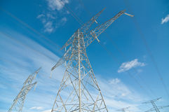 Electrical Transmission Towers (Pylons). A line of electrical transmission towers carrying high voltage lines Royalty Free Stock Photo
