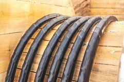 Electrical wire in black plastic braid for works on wood Babin. The horizontal frame. Royalty Free Stock Photos