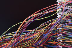Electrical wire and panel used in telecommunication and computer network. Colored electrical wire and panel used in telecommunication and computer network Stock Photos
