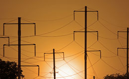Electrical Wires. View of a series of electrical wires against a sunset sky stock images