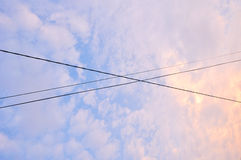 Electrical wires across evening sky Stock Photos