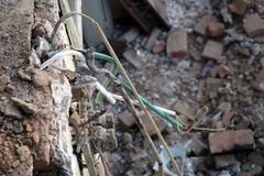 Electrical wires from ceiling from demolished house royalty free stock photography