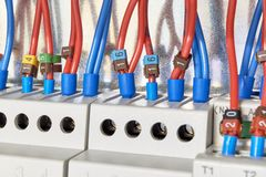 The electrical wires are connected to the relays and control devices royalty free stock photos