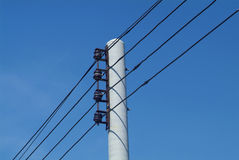 Electrical wires on pole. Details of electrical wires strung at the top of a power utility pole Royalty Free Stock Photography