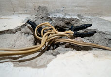 Electrical wires sticking out of the ruined wall.  royalty free stock photos