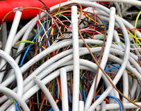 Electrical wires to the socket and insulated copper wire Royalty Free Stock Image