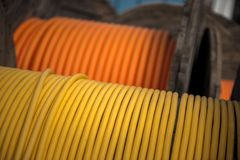 Electrical wires on wooden spool. Closeup Stock Photos