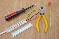 Electrical wiring. Domestic electrical wiring and basic electricians tools Stock Photos