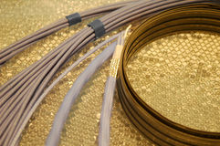 Electrical wiring. Assorted electrical wiring on a golden background Royalty Free Stock Photos