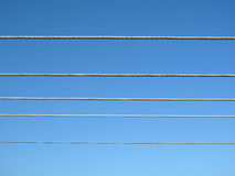 Electrical wiring on blue sky.  Royalty Free Stock Photography