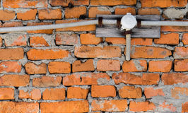 Electrical wiring on a brick wall. Outside Royalty Free Stock Photo