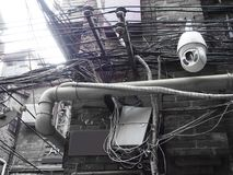 Electrical wiring, street scene in China, with surveillance camera. Electrical wiring in China, street scene in Shanghai Stock Image