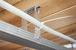 Electrical wiring in a suspended ceiling Royalty Free Stock Photo