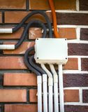 Electrical wiring on the wall. Electrical wiring is laid on the wall close-up Stock Photo