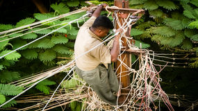 Electrical work. A man does work on the electrical wires in Madurai, India Stock Photos