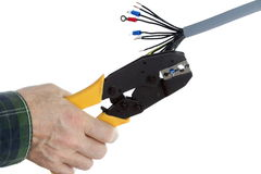 Electrical worker is crimping Stock Photo