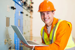 Electrical worker laptop computer royalty free stock image