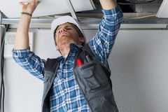 Electrical worker wiring in ceiling stock photos