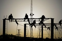 Electrical workers on electrified lines Stock Image