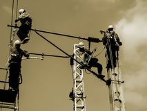 Electrical workers on overhead line royalty free stock photos