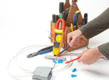 Electricial tools and parts electrician. Electrical tools and parts DIY with meter. Electrician testing wiring Royalty Free Stock Photos
