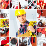 Electrician. Young smiling builder electrician and set of tools Royalty Free Stock Photography