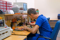 Electrician. The electrician is engaged in repair of an electric equipment Stock Photos