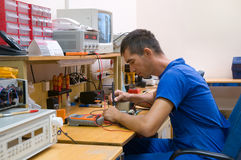 Electrician. The electrician is engaged in repair of an electric equipment Royalty Free Stock Photography