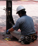 Electrician. Doing his job in the street Stock Photos