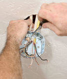 Electrician Attaching Ceiling Box Royalty Free Stock Image