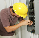 Electrician & Breaker Panel Stock Photo