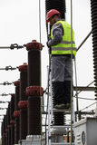 Electrician builder engineer.Electricity transformer at a power plant Royalty Free Stock Images