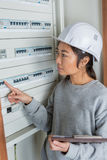 Electrician builder engineer worker in front fuse switch board Stock Photo