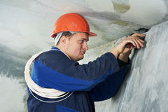 Electrician at cable wiring work Stock Photo