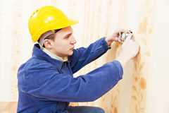 Electrician at cable wiring work Royalty Free Stock Photography
