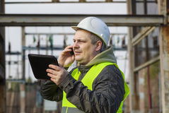Electrician with cell phone Royalty Free Stock Image