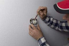 An electrician is checked with an indicator or the light switch royalty free stock photography