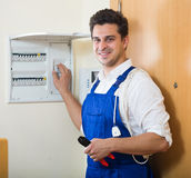 Electrician checking electric automatic control panel at home Stock Image