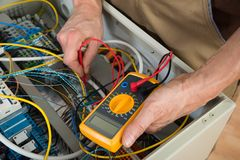 Electrician checking a fuse box Royalty Free Stock Photo