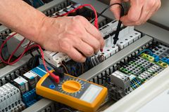 Electrician checking fuse Stock Images