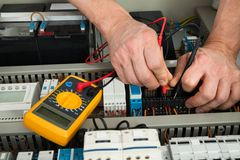 Electrician checking fuse Royalty Free Stock Photography