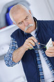 Electrician checking outlet with screwdirver Royalty Free Stock Images