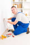 Electrician checking socket Royalty Free Stock Photos