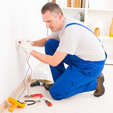 Electrician checking socket Royalty Free Stock Photography